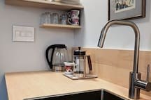 min kitchenette - coffee, fridge, sink, etc