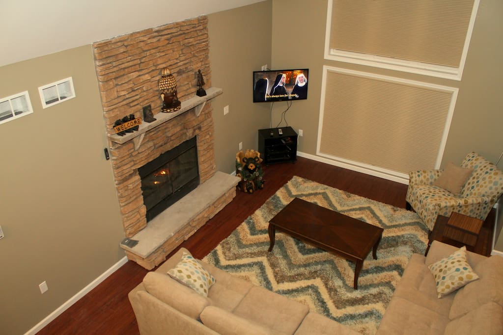 Open living room with Gas Burning fire place and 42'' LCD HDTV