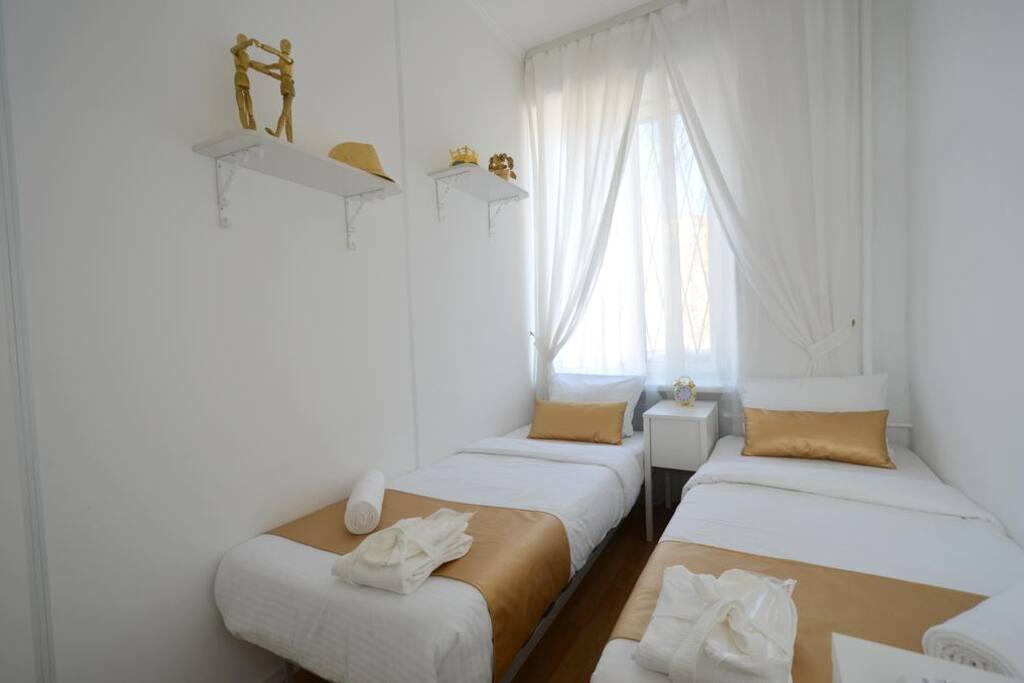 Двухместный отдельный номер с двумя односпальными кроватями