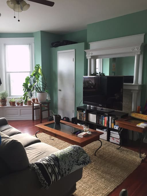 Front room: couch, coffee table, TV.