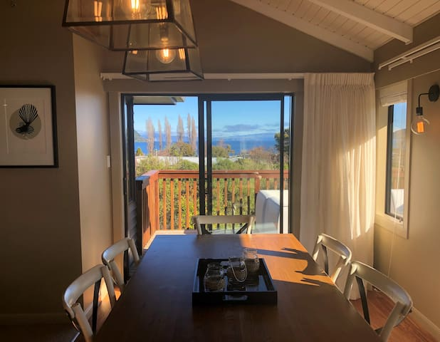 Stunning lake views from the living area, dining area and sun-deck