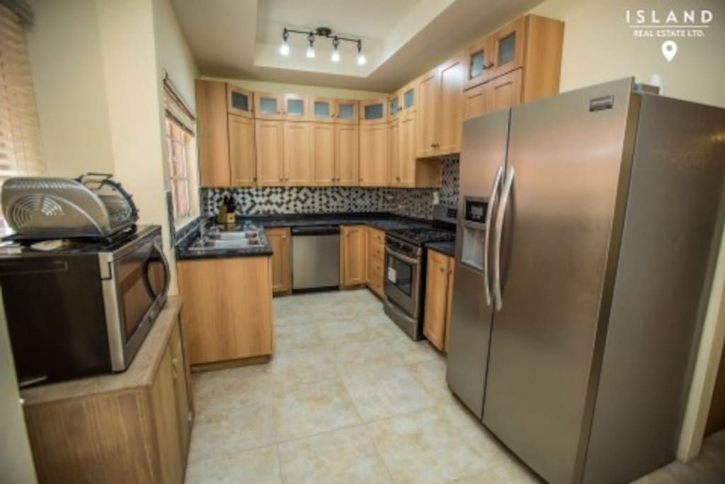 Complete fully furnished kitchen with new stainless steel appliances and kitchen utensils.