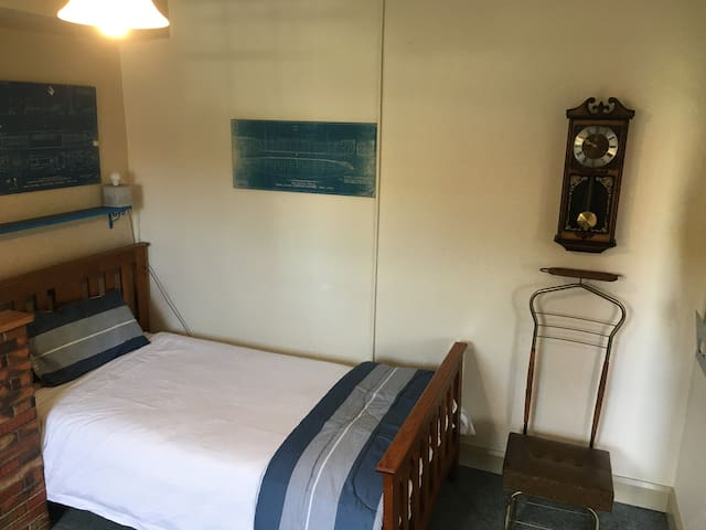 The Blue Boats room has 2 beds, this is a KIng Single with room to place your bags and hang your coat.