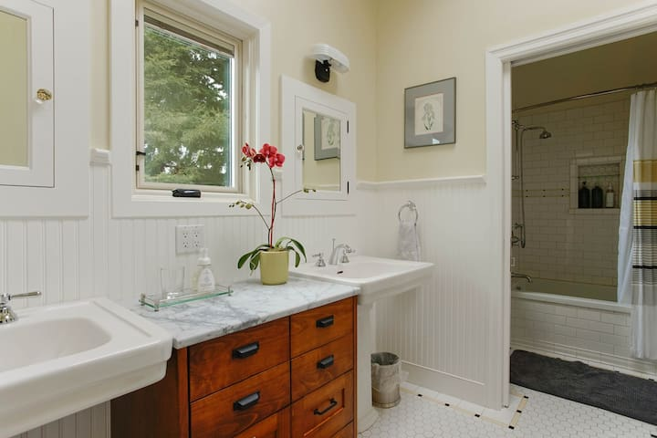 Pocket door separates the two areas of the bathroom.