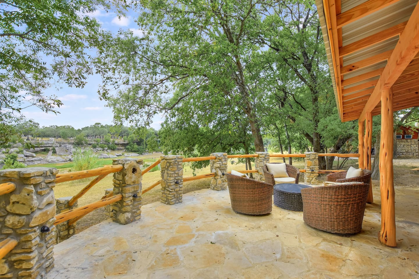 Gorgeous patio overlooking the Blanco River.