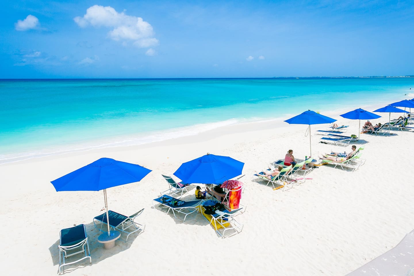 Seven Mile Beach at Cayman Reef Resort, where you will have easy access to beach chairs and umbrellas as well as a freshwater outdoor shower. No crowds like you might find at hotels and the best stretch of sugary sand in the Caribbean!
