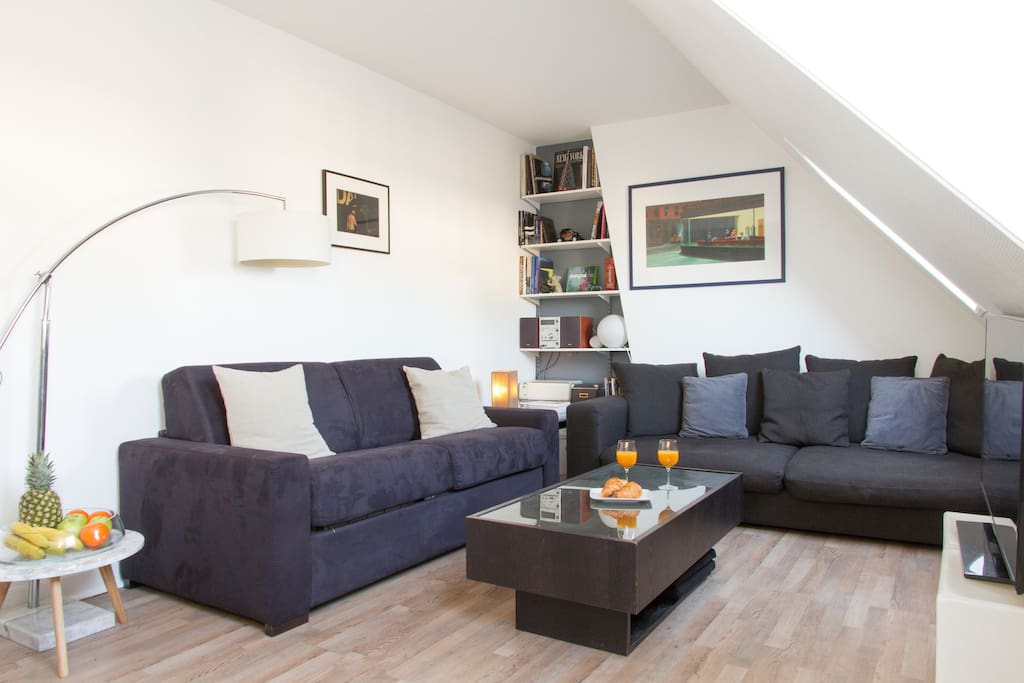 The cosy living area features a sofa bed, second couch, coffee table, flat-screen TV and more