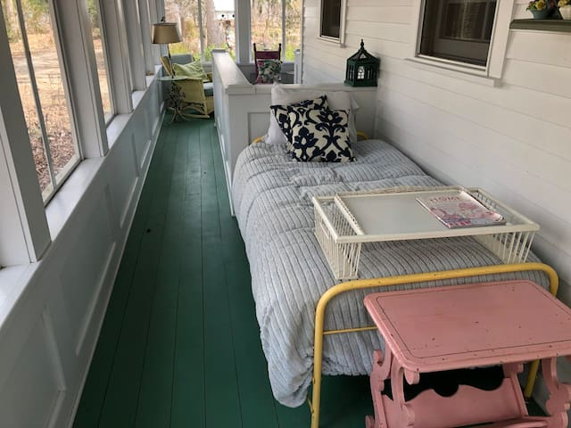Wrap-around porch with an un-advertised bed for the adventurous sleeper