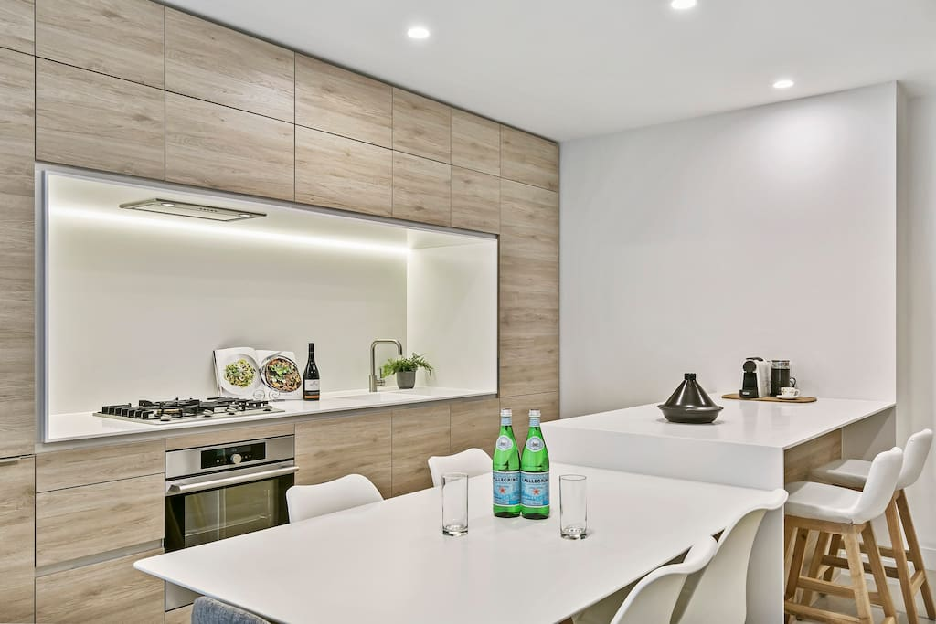 Sleek kitchen and meals area
