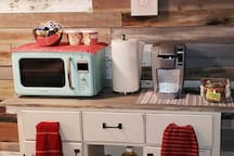 retro microwave, paper towels provided; wraps, storage bags, cooking oil, towels, coffee mugs, utensils.