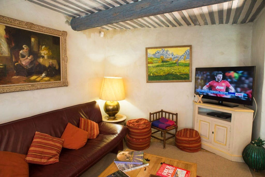 A comfortable living room with cable TV to relax after a stroll or for the rare but occasional rainy days.