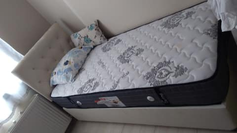 10 m2,separate room,table& chair with a single bed