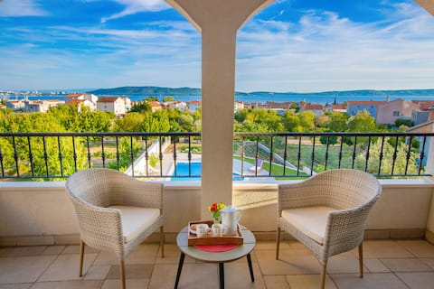 Villa Mendula - upper terrace detail with view at the bay