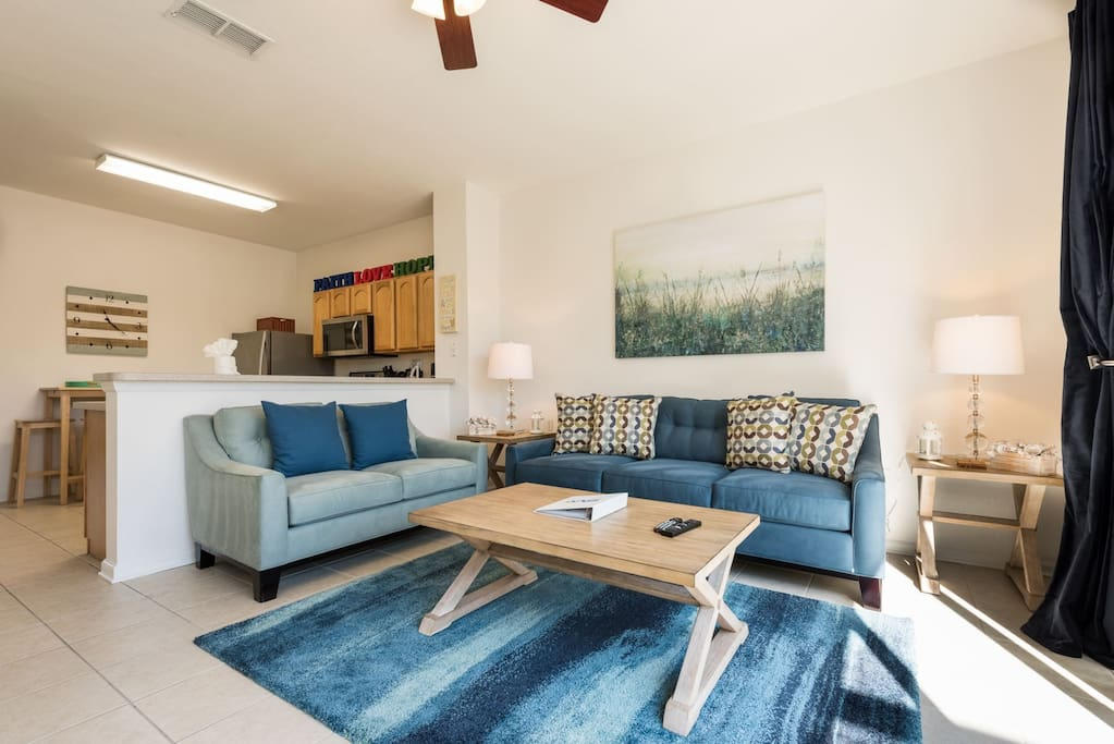 The bright and modern living room is tastefully decorated