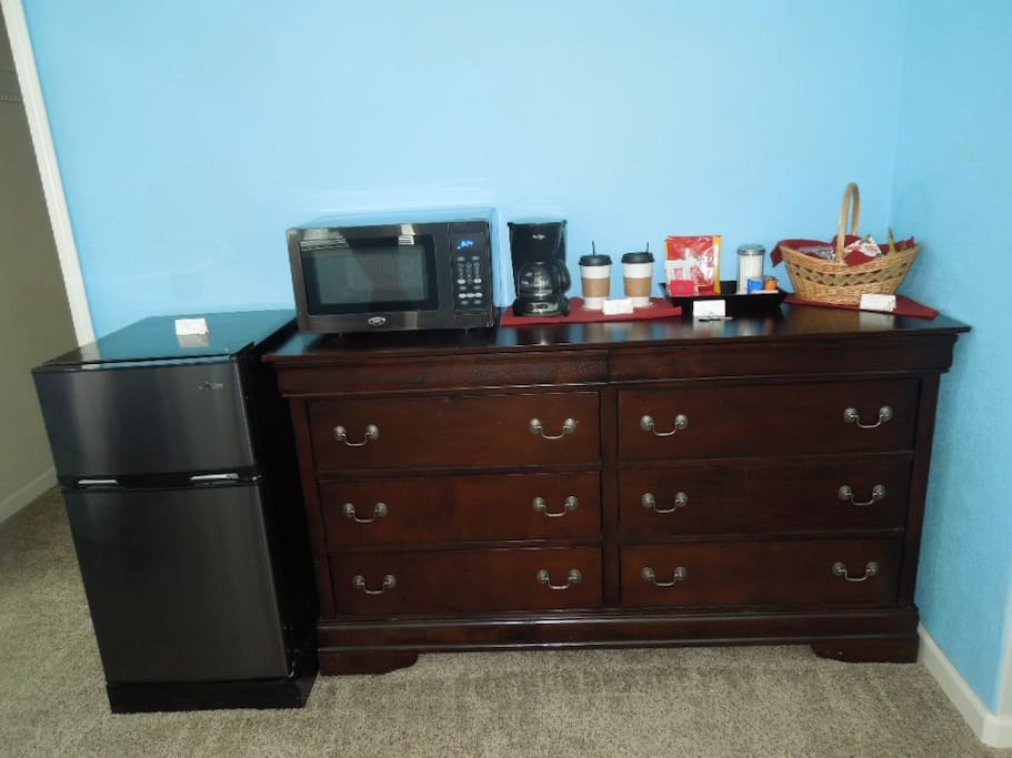 Mini fridge, microwave, stocked coffee bar, complimentary snack and seasonal fruit included