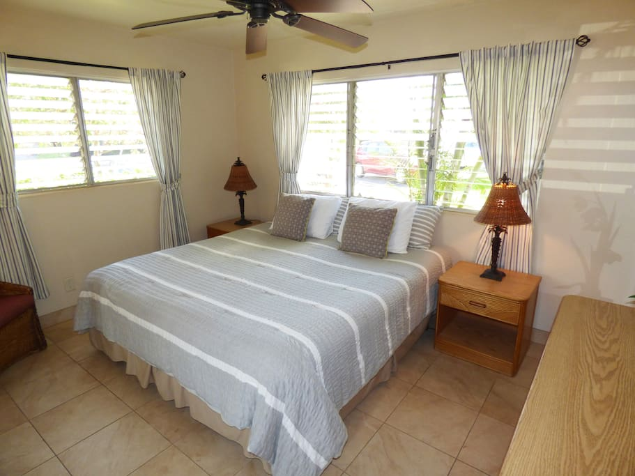 One bedroom with a King size bed