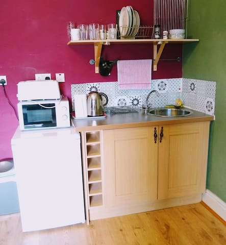 Kitchenette includes Microwave oven, Kettle, Toaster, Refrigerator and sink.