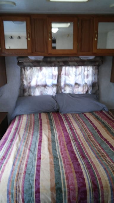 Full size bed, in separate bedroom