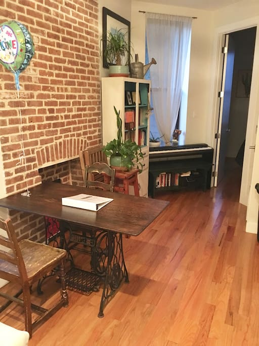 Hardwood floors and exposed brick give our apartment warmth and charm.