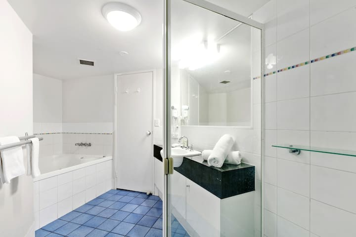Bathroom has a shower and spa bath