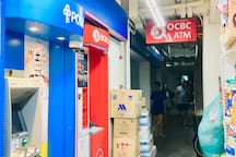 """Cash withdrawal ATM : """"POSB"""" & """"OCBC"""" next to """"NTUC FairPrice""""."""