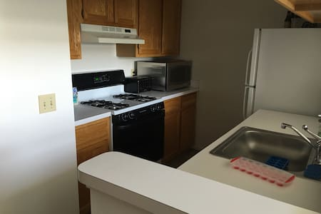 Spacious bedroom with nice bed - Charter Township of Clinton