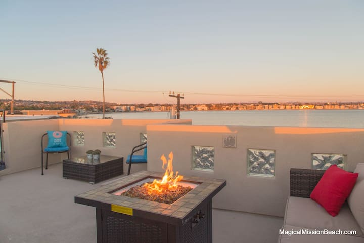 Rooftop Deck with views of bay and ocean. Cozy with lots of seating an a propane fire pit.