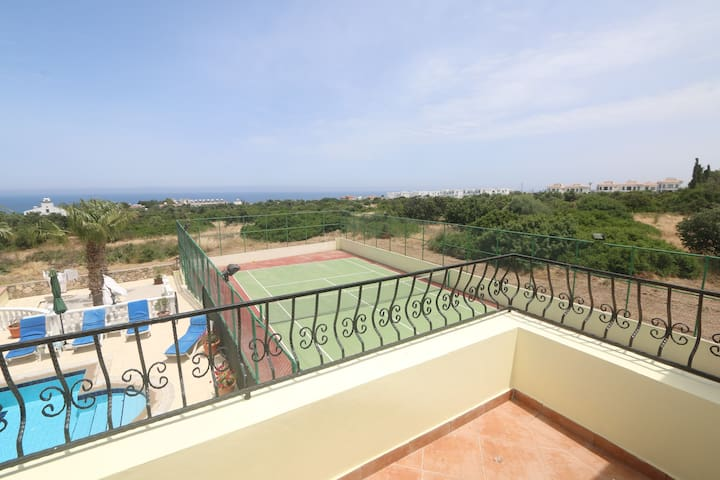View from top veranda , pool area & tennis court