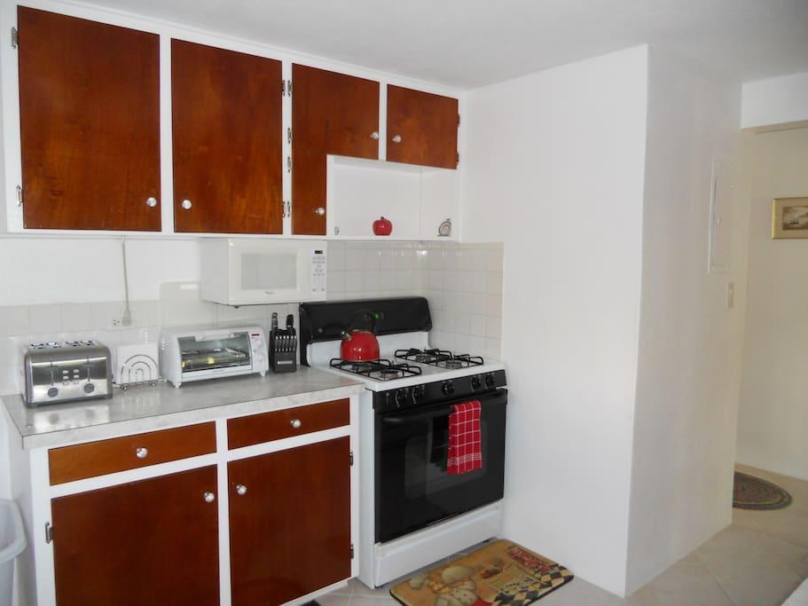 Kitchen, gas stove, microwave, toaster, toaster oven