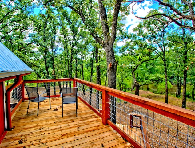 Enjoy a cup of coffee and some quiet time on this balcony.