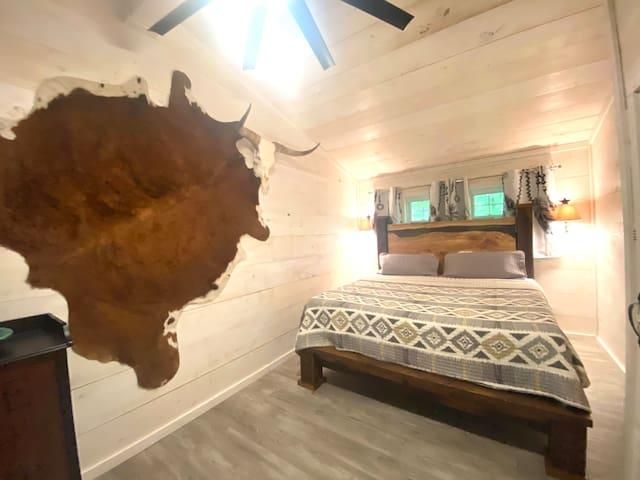 upper-level 2nd bedroom - live edge custom made king bed.