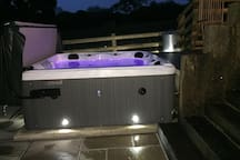 The hot tub is situated within its own private garden.