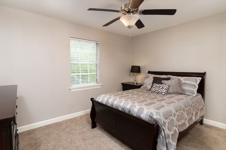 Spacious bedroom with comfortable full size bed.  Bedroom has Flat screen with cable TV, a private bathroom, and a walk-in closet.