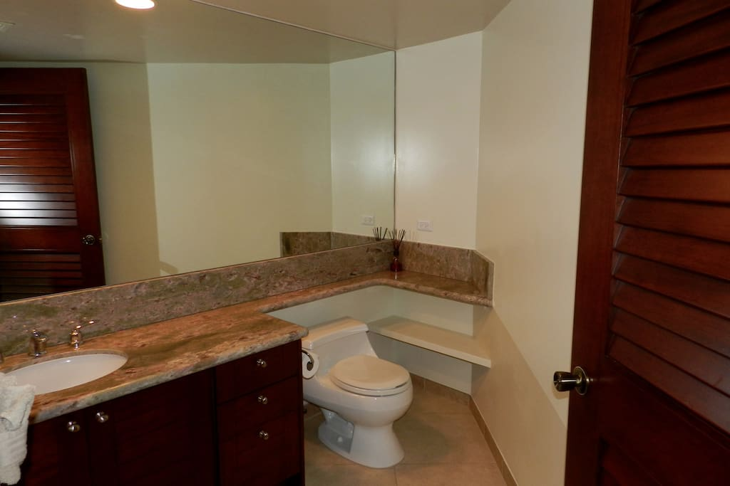 Convenient powder room off from living area.