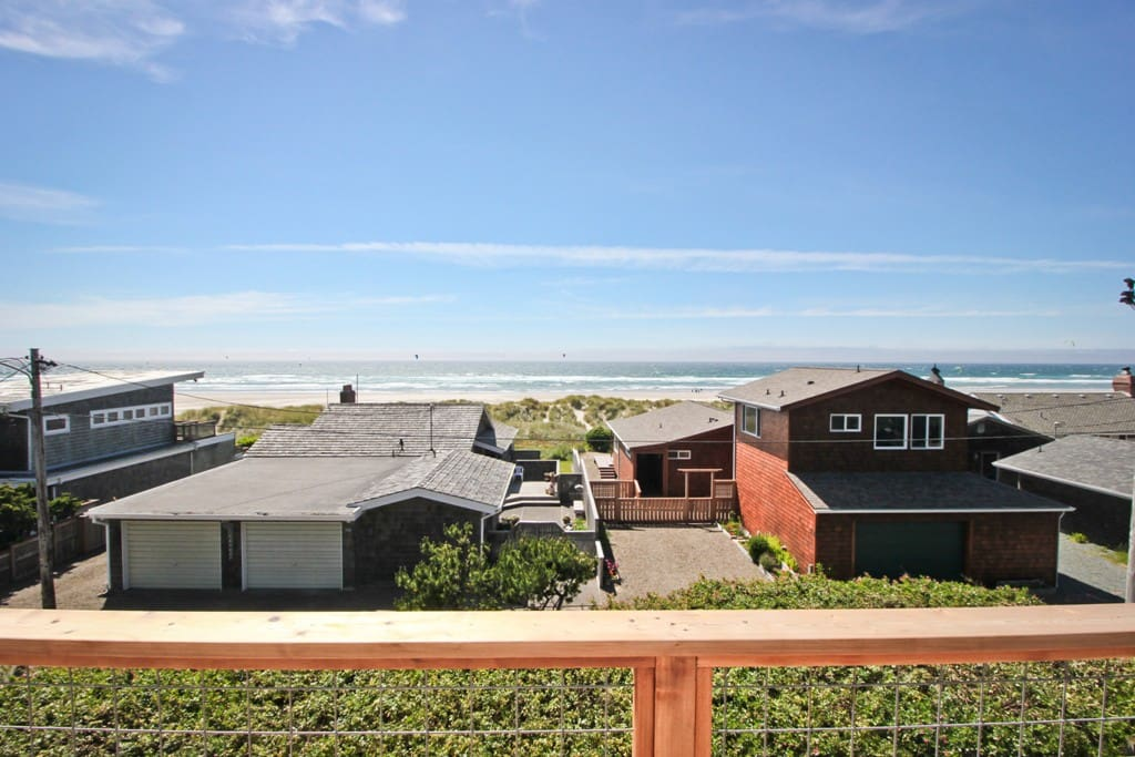 Large upper level wrap around deck with spectacular ocean views