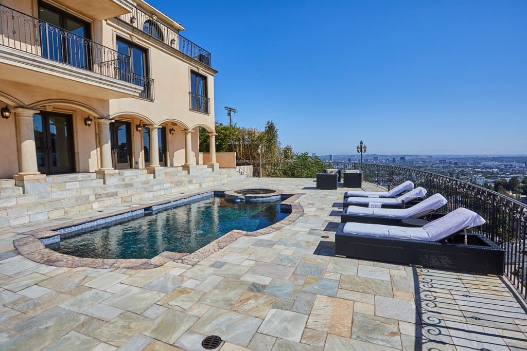 3,000 sq. ft deck with pebble stone heated pool and city views.