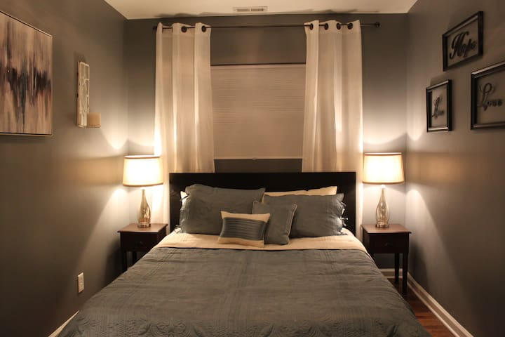 2nd Bedroom featuring comfy Queen Sized bed and beautiful custom Lighting accents!