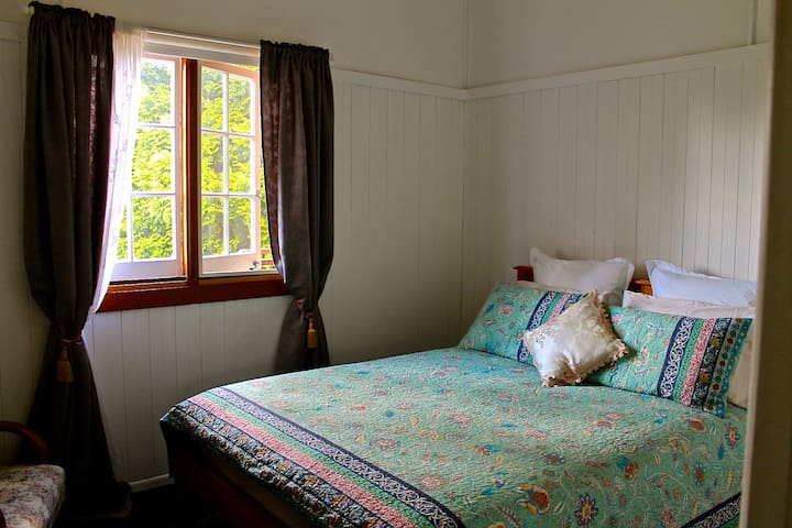 Beautiful bright bedroom with queen bed, dressing table, electric blanket.