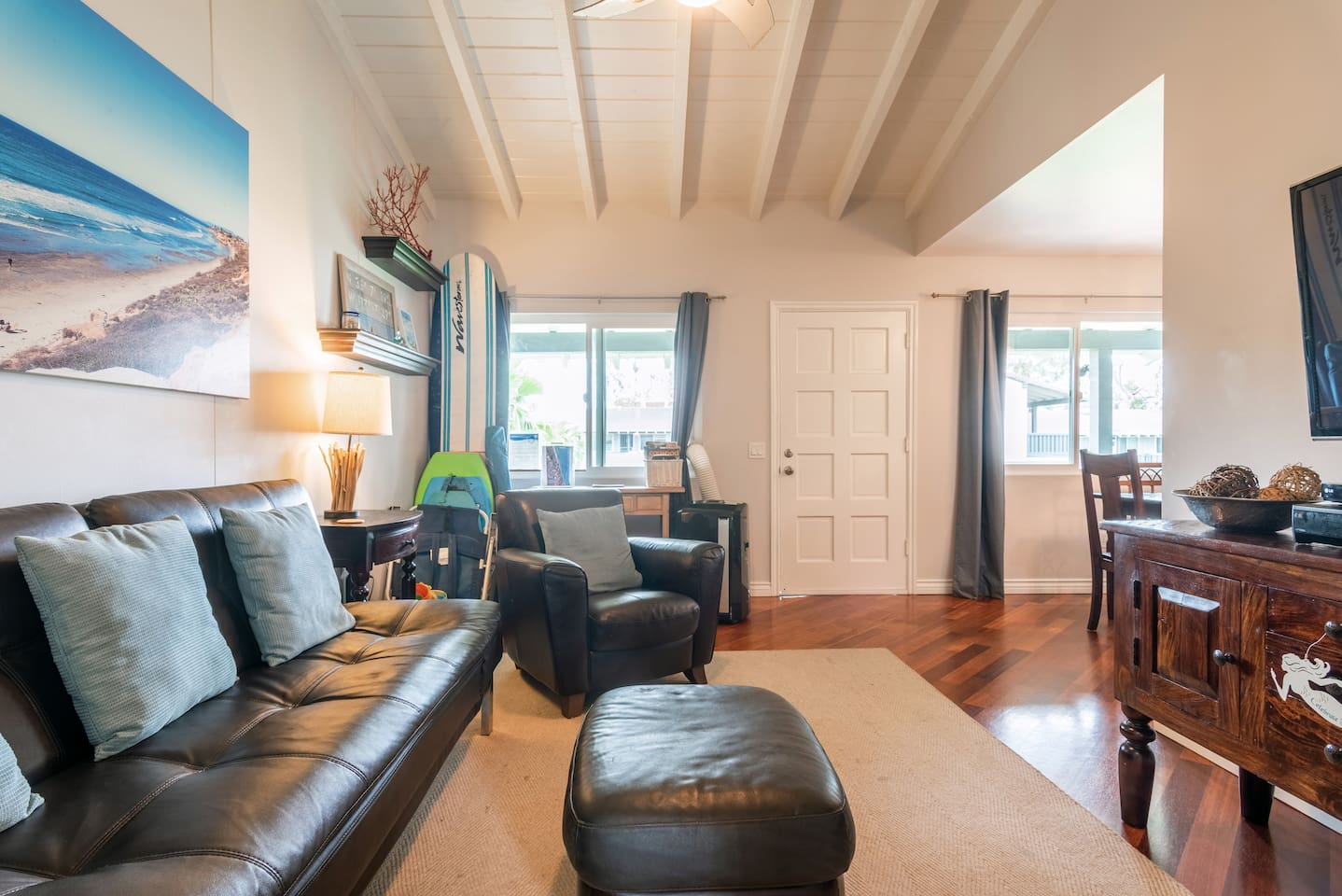 """Unwind in the living room which features a pull-out couch, vaulted ceilings, a 55"""" Smart-TV, A/C & heat."""
