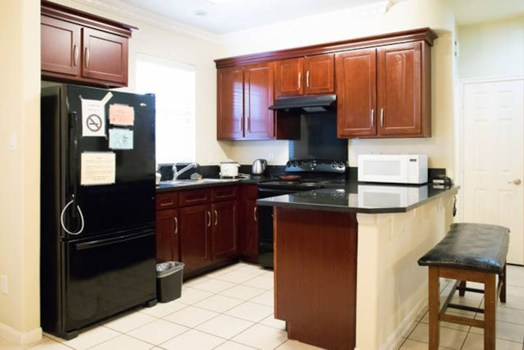 Full size Kitchen with granite counter top. tile floor thru out.