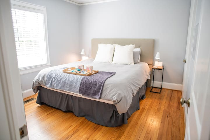 Cali-King bed with down comforter to help you melt away into a deep sleep.