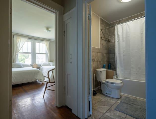 In between bathroom and bedroom 2