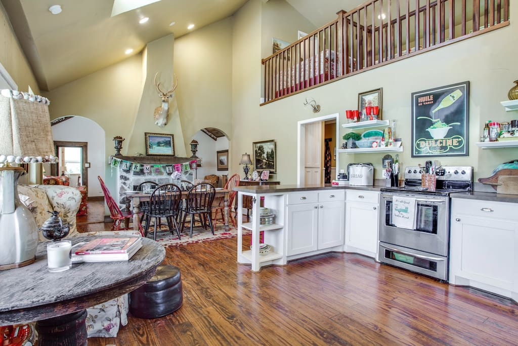 A well equipped kitchen with a fireplace in the dining room.