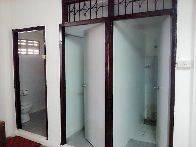 clean toilet and 2-shower rooms with warm water