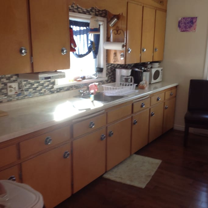 Kitchen counter with microwave and Keurig coffee machine
