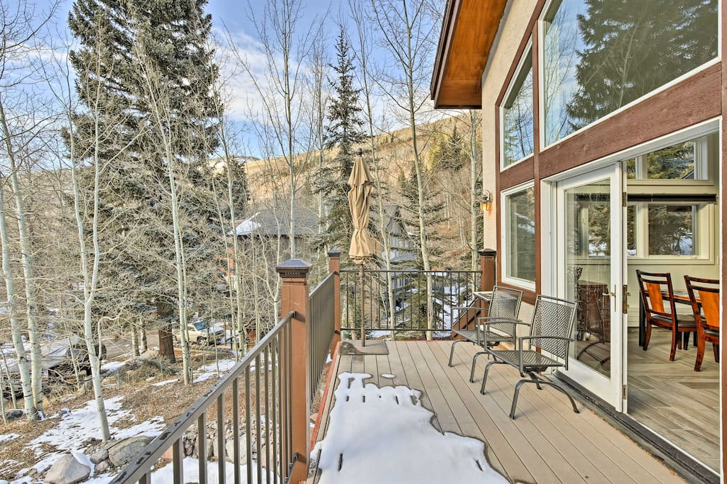 Take in the mountain views from the front porch of this Vail vacation rental.