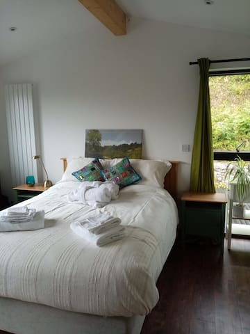 Your light and airy bedroom with king sized bed