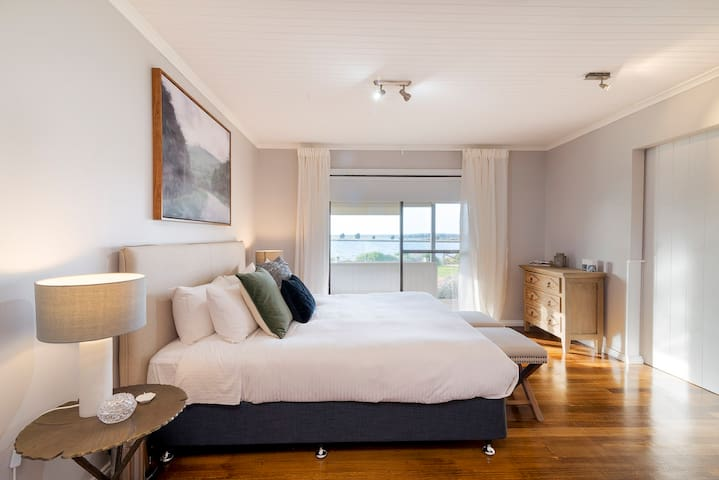 Master bedroom - wake up with water views every morning. Bedroom divided by the large barn doors in the living room and 2 by fold doors to the second bedroom.