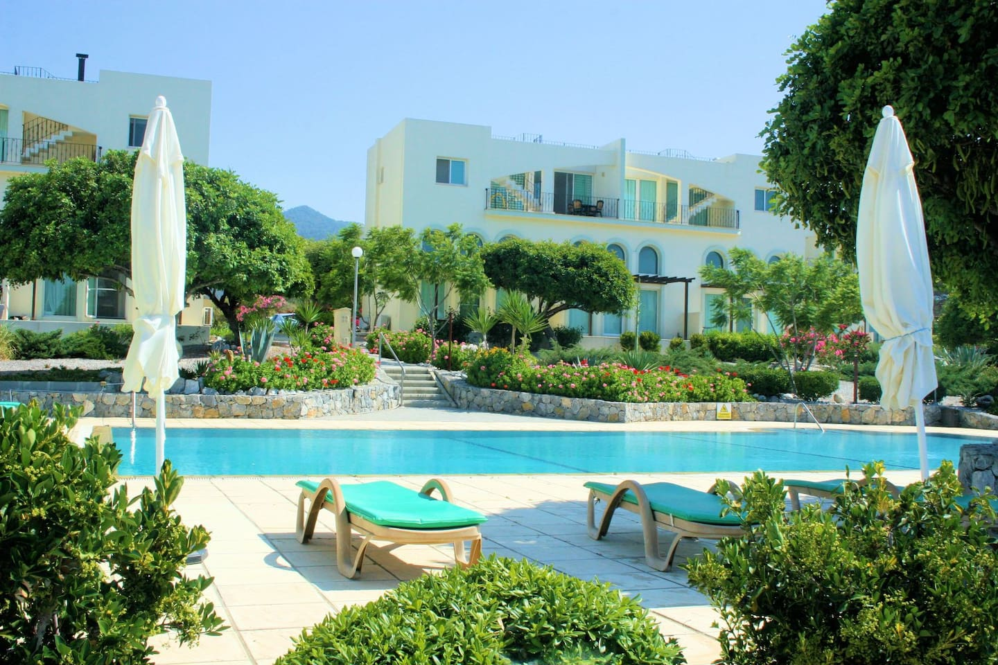Beautifully landscaped gardens with fabulously large swimming pool and sunbeds for free use by guests.