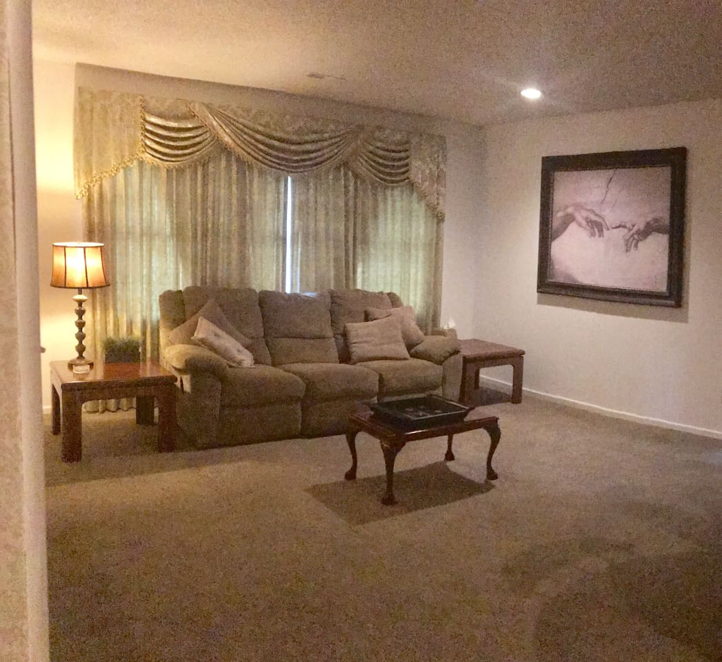 Comfortable double reclining sofa in spacious living room.